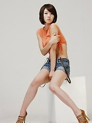 Hwang Mi Hee dresses in tight, tiny clothing to outline her slender legs and sumptuous cute tits