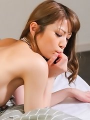 Yuria Asian whore sucks her finger while gets dick doggy style