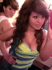 Busty chick infront of the mirror