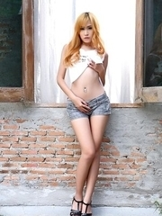 Redhead Asian doll Mayrita spreads her pussy
